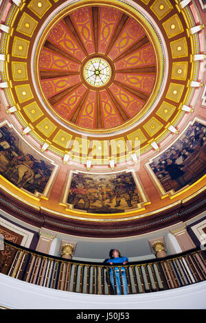 Montgomery Alabama State Capitol building woman visitor dome interior government balcony First Confederate Capitol - Stock Photo