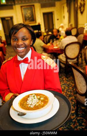 Selma Alabama St. James Hotel Black female student waitress employee serving gumbo - Stock Photo