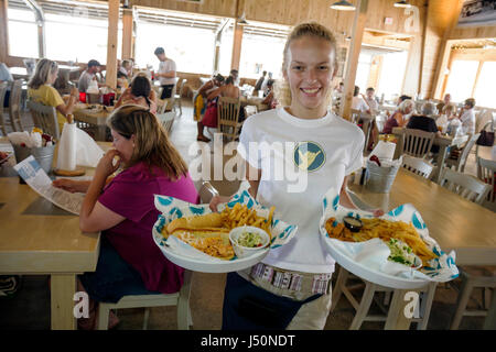 Gulf Shores Alabama The Hangout restaurant dining waitress seafood food serving - Stock Photo