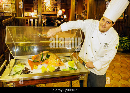 Point Clear Alabama Grand Hotel Marriott Resort hotel lodging lobby red snapper man chef fish food display - Stock Photo