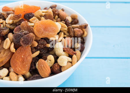 Assorted nuts and dry fruit in white bowl - Stock Photo