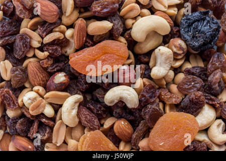 Assorted nuts and dry fruit background - Stock Photo