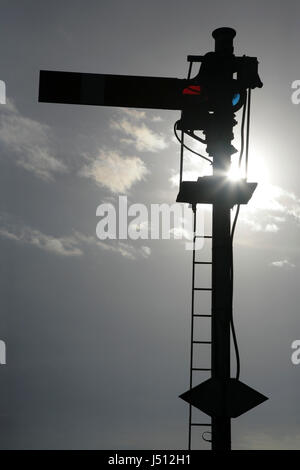 Old railway semaphore signal in the 'stop' position - Stock Photo