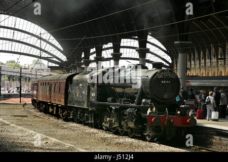 LMS Stanier class 8F steam locomotive 48151 at York station, UK with the Scarborough Spa Express charter train - Stock Photo