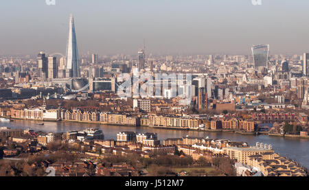 London, England, UK - February 27, 2015: The River Thames is lined with warehouses and apartment buildings as it - Stock Photo
