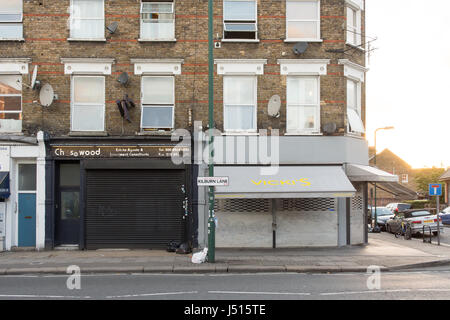 London, England - July 10, 2016: Traditional terraced houses and independent shops on Kilburn Lane in Kensal Rise, - Stock Photo
