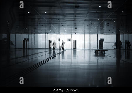 airport arrival arrivals travel traveller traveling air miles solo business trip trips frequent flyer flyers flying - Stock Photo