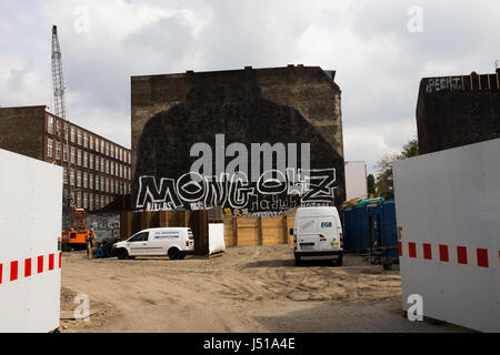 BERLIN, MAY 3TH: Building wall in Kreuzberg where a famous street art mural by the Italian Artist 'Blu' was painted - Stock Photo