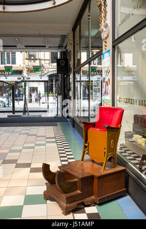 Old style shoeshine or gentlemens saloon chair in Barton Arcade Manchester UK - Stock Photo