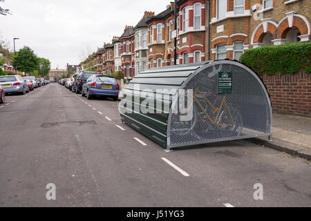 Bikehangar situated on a public road secure cycle parking on a uk urban london street - Stock Photo