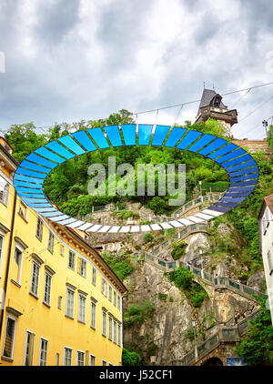 Graz, Austria - MAY 7, 2017: View of the Schlossbergplatz square in austrian Graz which is connected by steep staircase - Stock Photo