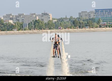 BUCHAREST, ROMANIA - SEPTEMBER 5, 2015. Acrobatic Jetsky pilot training on the lake. Aeronautic show. - Stock Photo