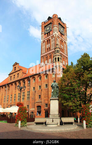 Town hall and Copernicus monument in Torun old town (Unesco world heritage site), Poland - Stock Photo