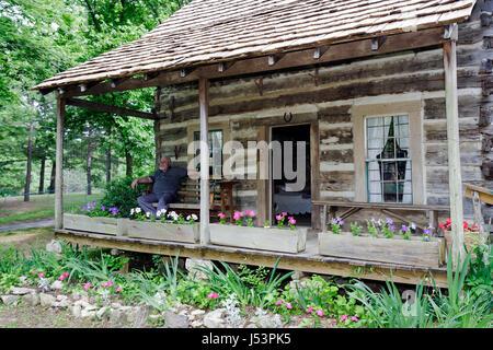 Arkansas Maynard Maynard Pioneer Museum and Park log cabin regional heritage historic preservation garden flower - Stock Photo