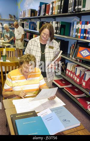 Arkansas Pocahontas Randolph County Library Genealogy Room woman women study read records census family tree history - Stock Photo