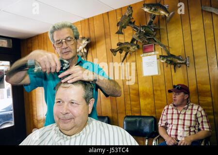 Arkansas Ozark Mountains Hardy Main Street Hardy Barber Shop man men haircut occupation service trim small business - Stock Photo