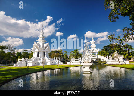 Wat Rong Khun The White Temple with pond in Chiang Rai, Thailand. - Stock Photo
