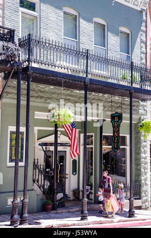 Arkansas Eureka Springs Spring Street historic building renovated shopping woman children wrought iron balcony specialty - Stock Photo