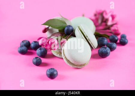 Close up of sweet macaroons with blueberries - Stock Photo