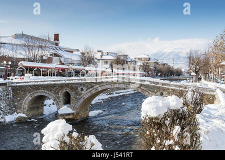 paving stones bridge and bistrica river of prizren, Kosovo at winter season - Stock Photo