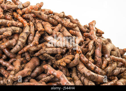Fresh turmeric roots display on sale in the fresh vegetable market - Stock Photo