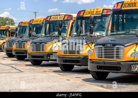 Cincinnati - Circa May 2017: Yellow School Buses in a District Lot Waiting to Depart for Students I - Stock Photo