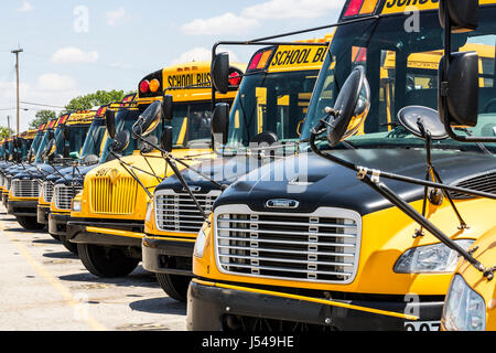 Cincinnati - Circa May 2017: Yellow School Buses in a District Lot Waiting to Depart for Students IV - Stock Photo