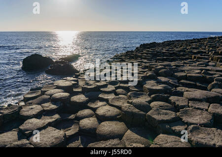 The famous ancient volcanic eruption - Giant's Causeway of County Antrim, Northern Ireland - Stock Photo