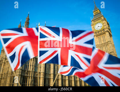 Great British Union Jack flag sflying in motion blur in front of Big Ben and the Houses of Parliament at Westminster - Stock Photo