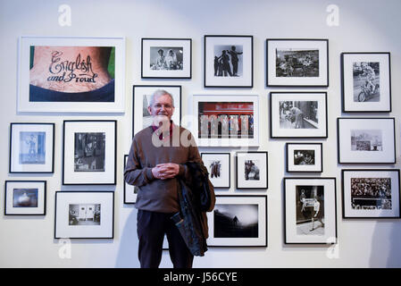 London, UK.  17 May 2017.  Magnum photographer, Martin Parr, stands in front of a collection of images.  His work 'English and Proud' is seen top left.  Preview of Photo London 2017 at Somerset House.  Now in its third edition, the event showcases the best in contemporary photography from 89 galleries from 16 different countries for collectors and enthusiasts. The show opens 18-21 May 2017.  Credit: Stephen Chung / Alamy Live News Stock Photo