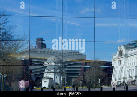Baskerville House, Library of Birming and Hall of Memory in Centenary Square Birmingham  reflected in the glass - Stock Photo