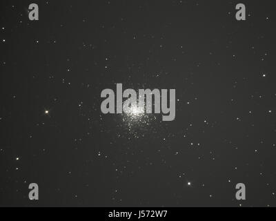 Great Globular Cluster in Hercules, Messier 13 (M13) composed of several hundred thousand stars - Stock Photo