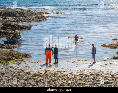People at Niarbyl beach on a sunny day, Isle of Man - Stock Photo