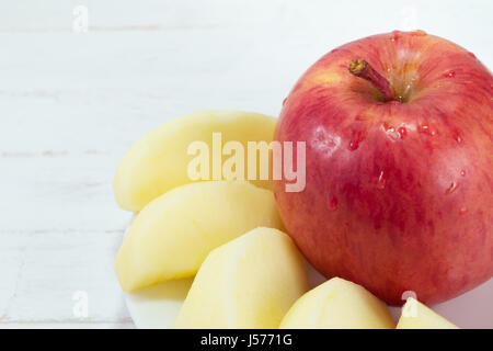 Red apples on white wood background - Stock Photo