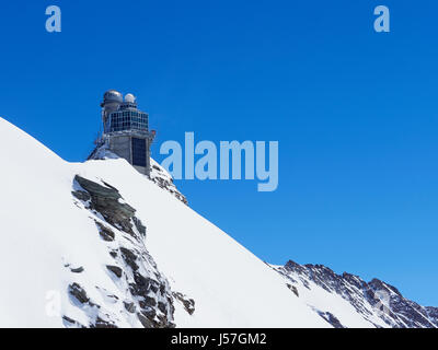 Switzerland the view from the Jungfraujoch plateau at 3454m 11333ft up to the Sphinx Observertory and the Aletsch - Stock Photo