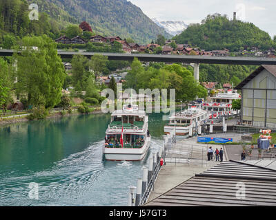 Switzerland Interlaken and the river Aare between the two lakes Brienz and Thun with the ferry leaving for Brinz - Stock Photo