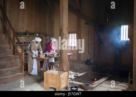 Cooking by a reenactment group, reconstructed medieval house, Nienover, Bodenfelde, Lower Saxony, Germany - Stock Photo