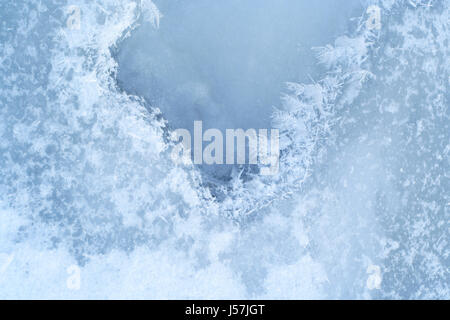 Close-up ice-bound water surface with crystals pattern at the winter time. - Stock Photo