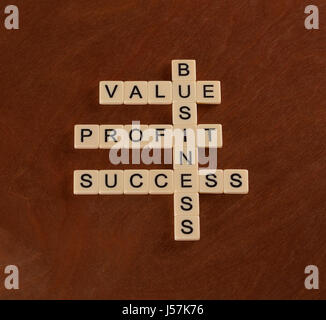 Crossword puzzle with words value, profit, business. Success in Business concept. Ivory tiles with capital letters - Stock Photo