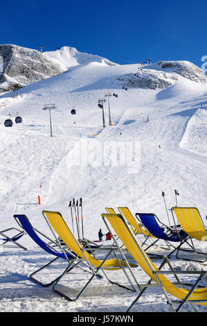 Chairs on the ski piste in Hintertux Zillertal, Austria - Stock Photo
