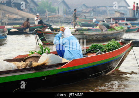 Indonesia, Borneo. For seller on the floating market near the Banjarmasin city on the Martapura river. - Stock Photo