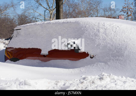 Red Car with Black and White Checkerboard Mirror Buried in Snow. - Stock Photo
