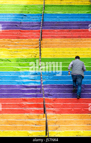 Istanbul, Turkey - April 25, 2016: stairs painted in rainbow colors in Istanbul, Turkey. man climbing stairs. Istanbul, - Stock Photo