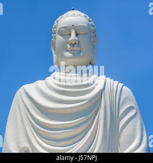 Nha Trang, Vietnam - March 18, 2014: White statue of Buddha in Long Son Pagoda in Nha Trang, Vietnam. - Stock Photo