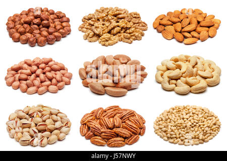 Set of various nuts isolated on the white background. - Stock Photo