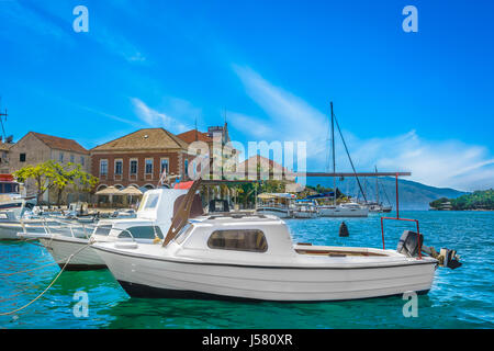 Waterfront view at city center of town Stari Grad, the oldest town in Croatia, Europe. - Stock Photo