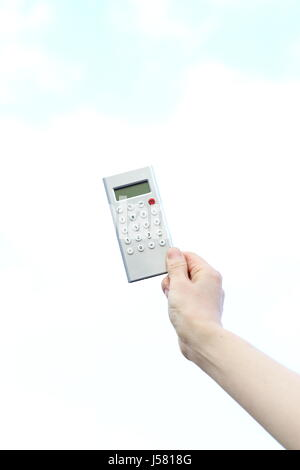 Woman Hand Holding Calculator - Stock Photo