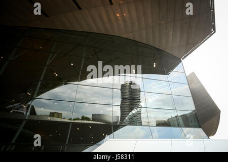 MUNICH, GERMANY - MAY 6, 2017 : A reflection of the BMW Museum in the window of BMW Welt exhibition center in Munich, - Stock Photo