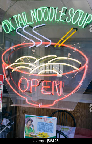 Orlando Florida Colonial Drive Little Vietnam neon sign ox tail noodle soup restaurant window advertise ethnic cuisine - Stock Photo