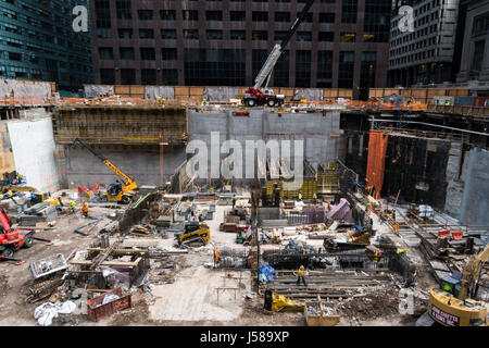 Construction Site in New   with Tradesmen ,York City, USA - Stock Photo